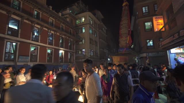 crowded kathmandu street scene at night with bunga dyah chariot - kathmandu stock videos & royalty-free footage