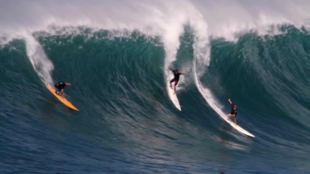 WS POV Crowded lineup and surfers riding on  waimea bay  / Haleiwa, Hawaii, United States