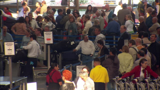 ms, ha, crowded los angeles airport terminal, los angeles international airport, los angeles, california, usa - lax airport stock videos & royalty-free footage