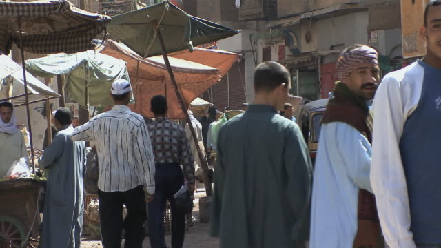 ms zo crowded market scene, assyout, egypt - arabic script stock videos and b-roll footage