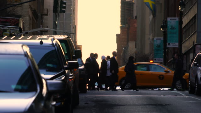 crowded midtown manhattan traffic during the evening commute time on mar. 29 7017. commuters cross the street among the congestion traffic. the silhouettes of commuters appear in the sunset glow sky. - mar stock videos & royalty-free footage