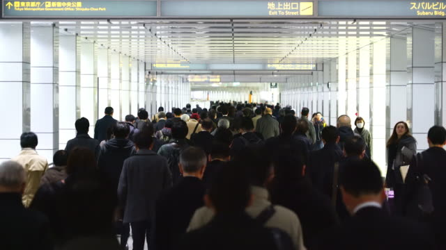 tl crowded morning commute scene at jr shinjuku station underground passage.commuters going through the underground passage to shinjuku subcenter business district. - station stock videos & royalty-free footage