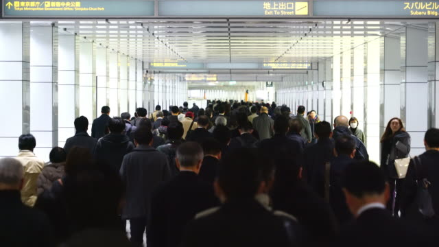 crowded morning commute scene at jr shinjuku station underground passage.commuters going through the underground passage to shinjuku subcenter business district. - station stock videos & royalty-free footage
