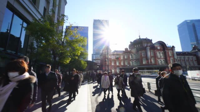 Crowded morning commute scene at Marunouchi Business District.Commuters go to Marunouchi Business District from Tokyo Station.