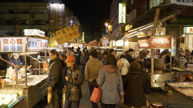 ts ws crowded night market, guangzhou street, taipei, taiwan - night market stock videos & royalty-free footage