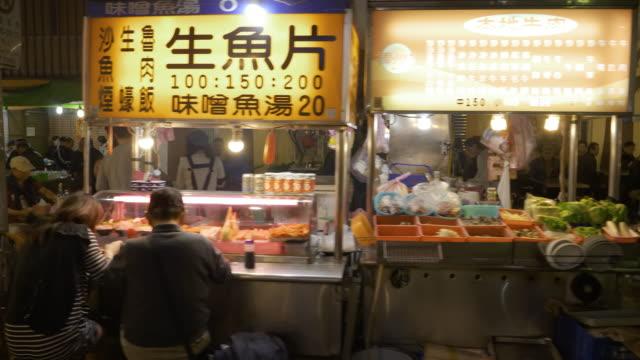 ts ms crowded night market, guangzhou street, taipei, taiwan - night market stock videos & royalty-free footage