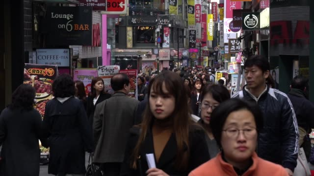 crowded of people walking in the streets of seoul, south korea - seoul stock videos & royalty-free footage