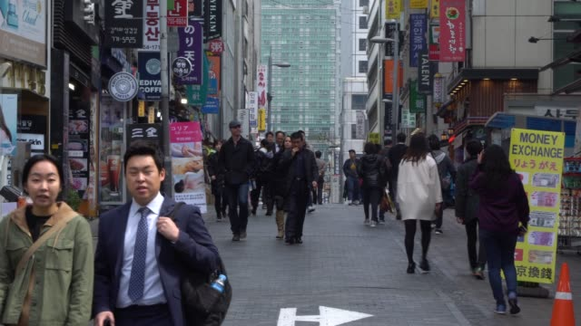 crowded of people walking in the streets of seoul, south korea - korea stock videos & royalty-free footage