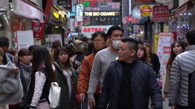 ソウルの街を歩く人混み - 韓国文化点の映像素材/bロール