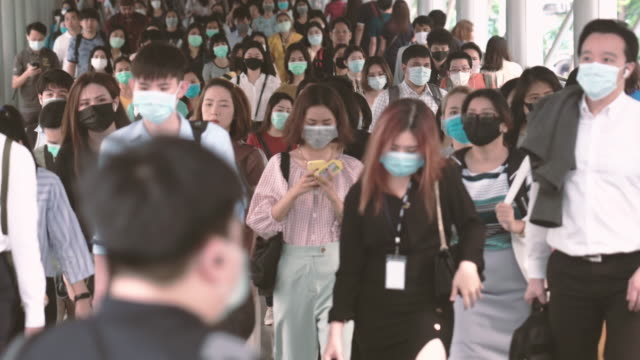 crowded of people wearing a face mask to prevent coronavirus or covid19 outbreak - elevated train stock videos & royalty-free footage