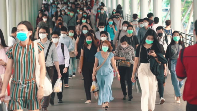 crowded of people wearing a face mask to prevent coronavirus or covid-19 outbreak - surgical mask stock videos & royalty-free footage