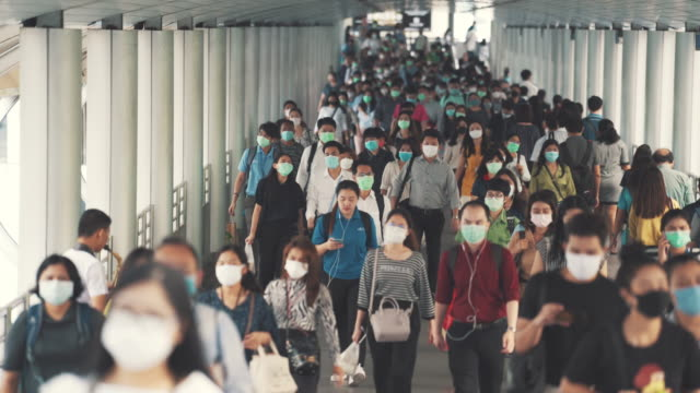 crowded of people wearing a face mask to prevent coronavirus or covid-19 outbreak - elevated train stock videos & royalty-free footage
