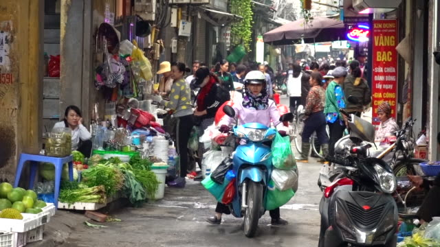crowded open air market in hanoi - scooter stock videos & royalty-free footage