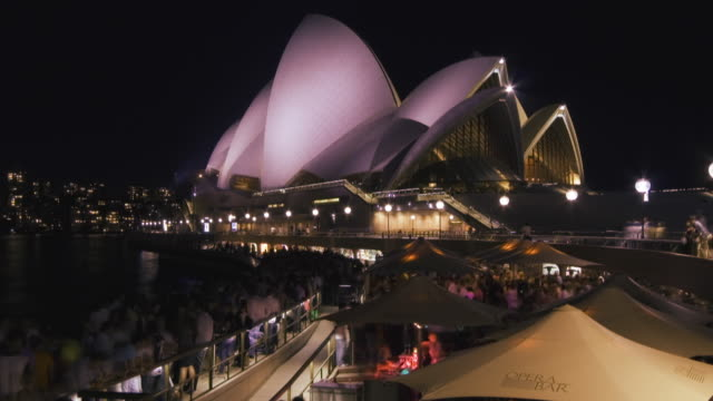 T/L WS ZI Crowded outdoors cafes and Sydney Opera House at night, Sydney, Australia