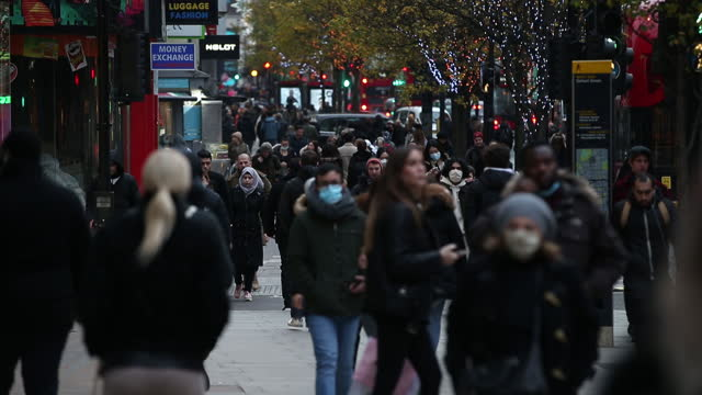 crowded oxford street and shops, reopened after lockdown, in city of london, london, england, u.k., on wednesday, december 2, 2020. most of england's... - shopping bag stock videos & royalty-free footage