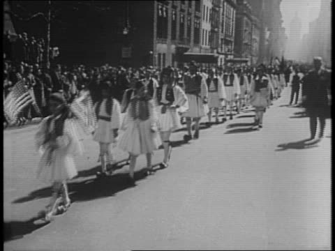crowded parade route along a new york city street / women march down the street with a banner reading ' help for greece in her fight for democracy' /... - 1941 bildbanksvideor och videomaterial från bakom kulisserna