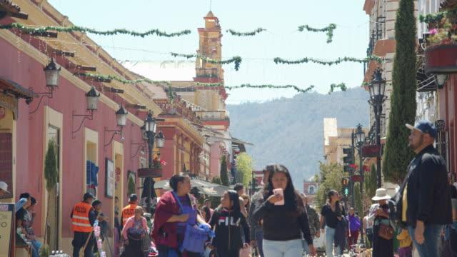 crowded pedestrian street on a sunny day in downtown san cristobal de las casas, chiapas, mexico - latin america stock videos & royalty-free footage