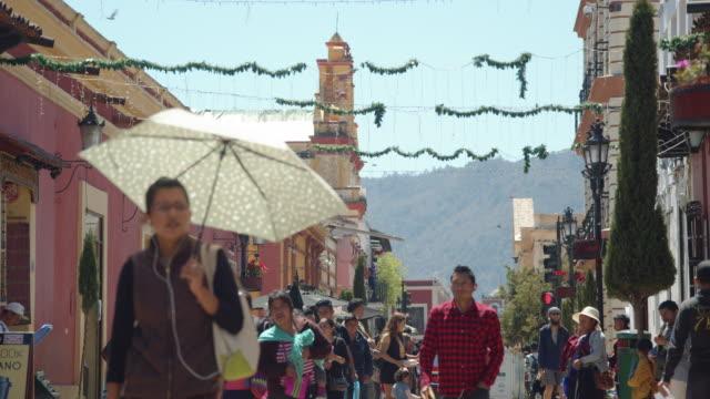 a crowded pedestrian walkway in san cristobal de las casas, chiapas, mexico - heat stock videos & royalty-free footage