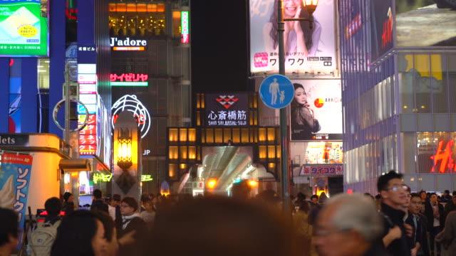 crowded people at osaka night street market in Japan