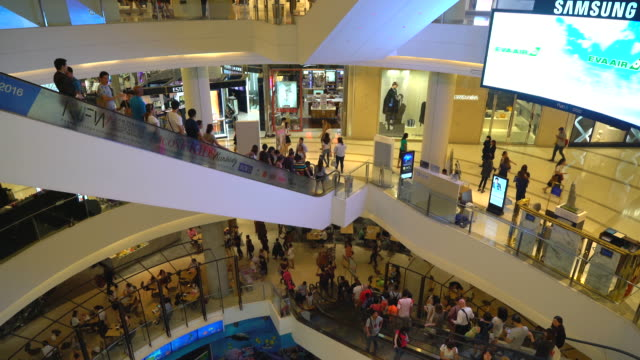 crowded people in luxuly shopping mall - inside of stock videos and b-roll footage
