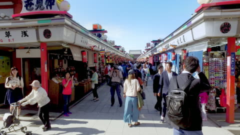crowded people on business street in tokyo temple - shrine stock videos & royalty-free footage