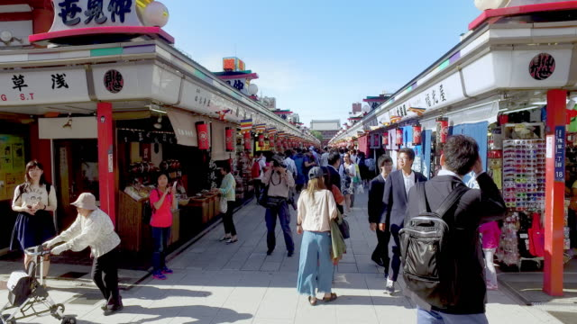 crowded people on business street in tokyo temple - shrine stock videos and b-roll footage