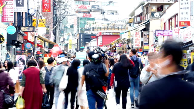 crowded people on business street in tokyo.timelapse - south stock videos & royalty-free footage