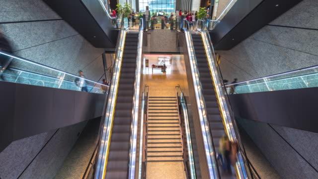 crowded people on escalator in modern mall. timelapse 4k hyperlapse