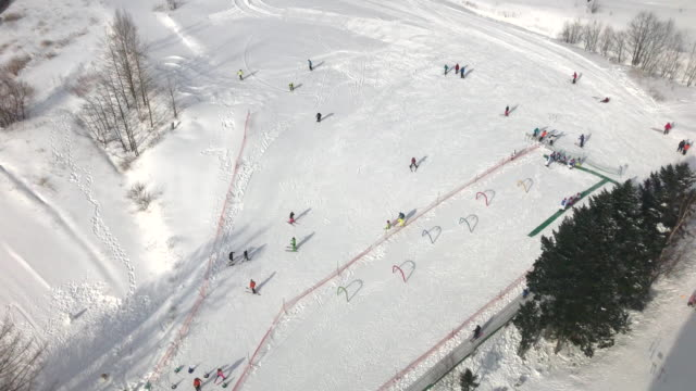 crowded people skiing on snow ground