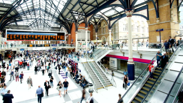crowded people train station, liverpool street, in london, time lapse - passenger train stock videos & royalty-free footage