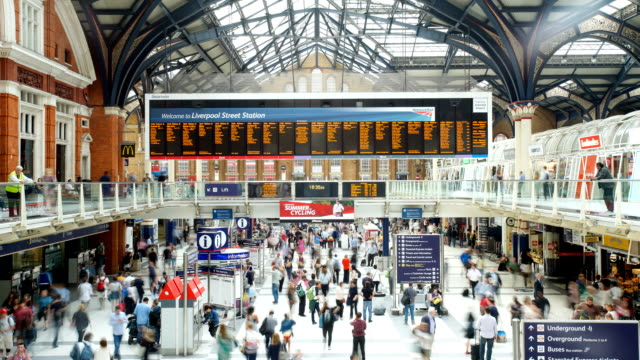 crowded people train station, liverpool street, in london, time lapse - railway station stock videos & royalty-free footage