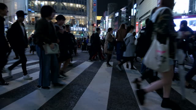 crowded people walking - zebra crossing stock videos & royalty-free footage