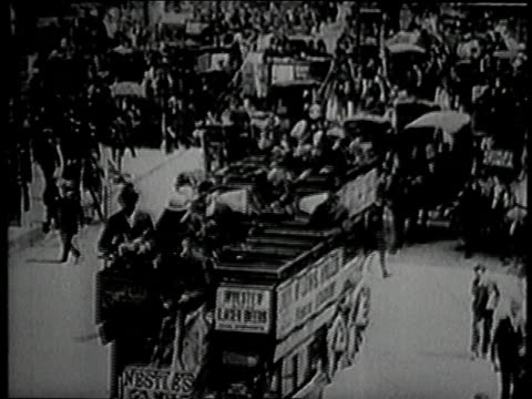 crowded piccadilly busy with horse drawn carriages passengers riding on buses / piccadilly circus london united kingdom - 1916 stock videos & royalty-free footage