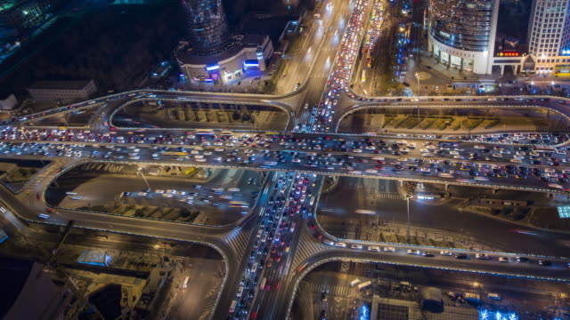 T/L WS HA PAN Crowded Road Intersection at Night / Beijing, China