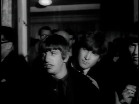 ws crowded room / pan beatles / cu awards for each member / beatles on stage receiving awards - receiving stock videos and b-roll footage