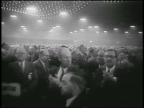 B/W 1955 crowded room of union delegates clapping / AFLCIO merger / NYC / newsreel