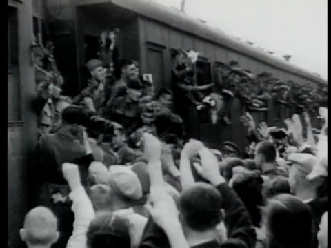 vídeos de stock, filmes e b-roll de crowded russian troop passenger train leaving crowded station soviet soldiers leaning out of windows crowd of people waving to soldiers the great... - 1943
