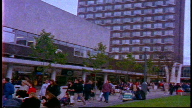 crowded shopping plaza in london on super 8 film - grainy stock videos & royalty-free footage