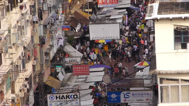 crowded shopping street from above - sham shui po - medium wide - day - spoonfilm stock-videos und b-roll-filmmaterial