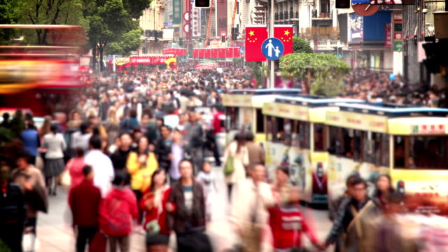 crowded shopping street in shanghai (nanjing road) - chinese flag stock videos and b-roll footage