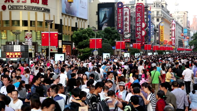 crowded shopping street - chinese flag stock videos and b-roll footage