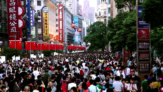 crowded shopping street - chinese flag stock videos & royalty-free footage