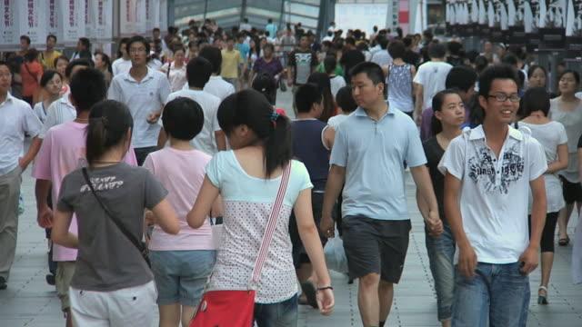 slo mo ws crowded sidewalk / ningbo, zhejiang, china - zhejiang province stock videos & royalty-free footage