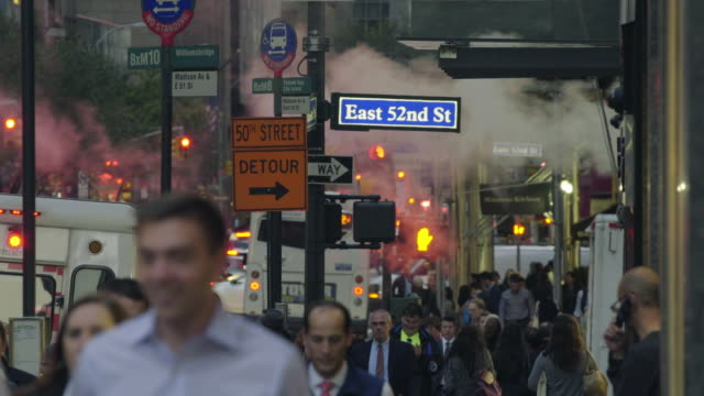 crowded sidewalk - street name sign stock videos and b-roll footage