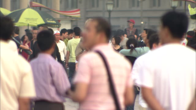 ms selective focus crowded sidewalk with tall man prominent, shanghai, china - three quarter length stock videos & royalty-free footage