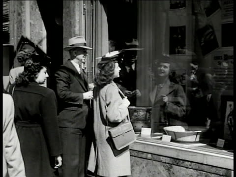 crowded street 5th avenue ny ws window shoppers at cook's travel agency cu sign 'mexico tours' int vs men behind counters customers mexico posters cu... - 1948 stock videos & royalty-free footage