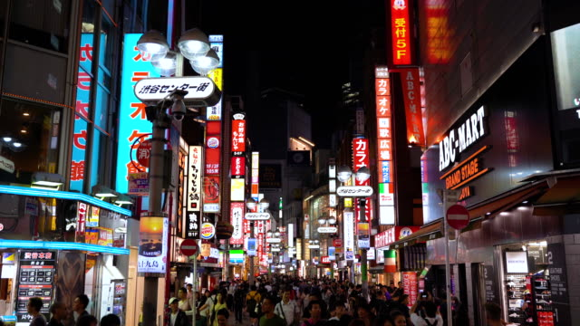 crowded street at night in osaka with illuminated signs - japan stock videos & royalty-free footage