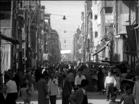crowded street during suez crisis port said egypt 12 nov 56 - port said stock videos & royalty-free footage