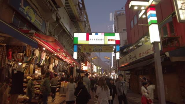 vídeos y material grabado en eventos de stock de ws slo mo crowded street in city at sunset, okachimachi, tokyo, japan - lugar de comercio