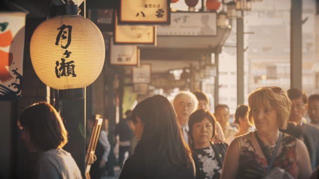 crowded street in kyoto - retail place stock videos & royalty-free footage